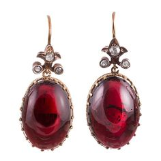Victorian Cabochon Garnet & Rose Cut Diamond Earrings. Lovely cabochon garnet earrings, topped with a flour-de-lys shaped finial and decorated with rose cut diamonds. These earrings are beautiful from every angle, with a detailed crownlike setting that is best appreciated form the side. 1.25 inches. 15k yellow gold.