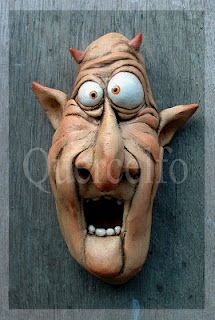 Note to self - start dark-washing my crazy face sculptures...