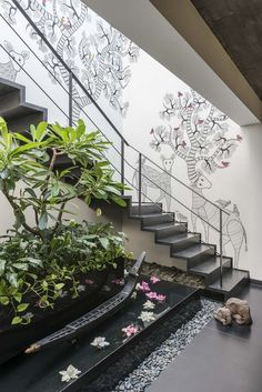 Read the article !Tree of Life - a Gond painting is sketched beautifully on this staircase in a penthouse in Mumbai. Such a refreshing change from a gallery wall often seen in such places. Stairs Architecture, Landscape Architecture Design, Landscape Stairs, Landscape Plans, Landscape Art, Garden Stairs, House Stairs, Home Room Design, Home Interior Design