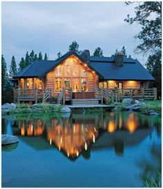 i LOVE log cabins...especially on lakes