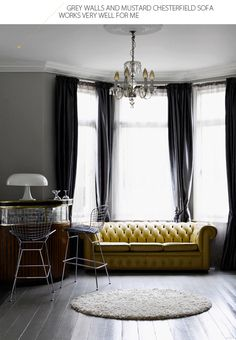 Grey painted wooden floors, mustard Chesterfield and charcoal velvet curtains in this opulent living room. Wow!!!!!!