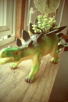 Succulent plastic toy animal planters.  I can just imagine a whole zoo on the window ledge!  ( :