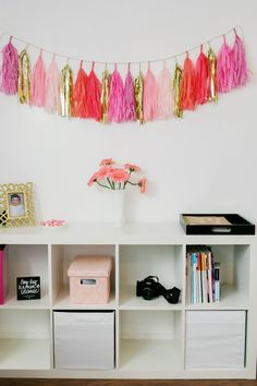Decorate your expedit with a pink tassel garland for extra flair.  Best Friends For Frosting x IKEA West Sacramento.