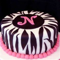 Zebra Stripes - I made this cake for a birthday. The cake is a white cake with strawberry buttercream filling. The cake covering and stripes are fondant and the N is gumpaste/fondant. This was a fun one! Zebra Print Cakes, Zebra Cakes, Beautiful Cakes, Amazing Cakes, Cake Cookies, Cupcake Cakes, Cupcake Wrappers, Zebra Birthday Cakes, Birthday Cake Girls Teenager