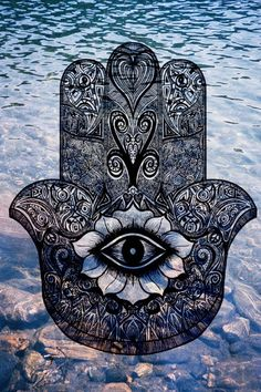 A Hamsa hand: Symbolizing the Hand of God. It's a protective sign bringing it's owner happiness, luck, health, joy, & good fortune