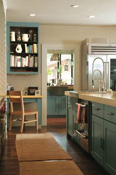 """""""Colorado Homes and Lifestyles's Kitchen of the Year designed by Margie McCulloch of Red Pepper Kitchen and Bath Design out of Boulder.  Cabinet color BM Oregon Teal Tile Ann Sacks"""""""