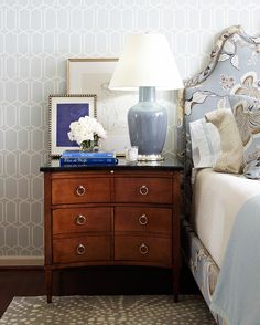 Suburban House with Great Color -Traditional Home. Graphic wall paper, fabric headboard, blue and tan palette.