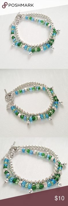 Blue Green Beaded Bracelet Brand new handmade double layer beaded bracelet.   Materials used: 4mm glass beads, 4mm silver plated round and cube beads, toggle clasp. Jewelry Bracelets
