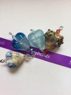 Handmade lamp work glass beads.