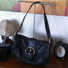 "Small Black Leather Hobo In excellent condition. Inside shows some dirt stains. Some TLC will do wonders. Black leather, contrast white stitching. Silvertone hardware. Bag tag. Two compartments plus zipper pocket inside. Two patch pockets. Key fob loop. Strap drop 8.5"". L 11"" H 7"" W 1"". ID# G050 9247 Coach Bags Hobos"