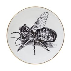 Rory's beautiful Queen Bee illustration on a plate with a refined gold edge.