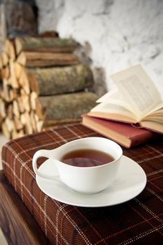 Cozy cup of tea and a book by the fireplace