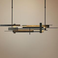 This contemporary LED island light pendant offers you a sleek, minimalist design.