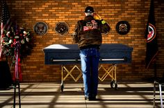 """U.S. Navy veteran and Patriot Guard Rider Leonard S. Salazar renders a final salute to Colorado native, Micki Raymond Jerdon, 65, a Vietnam-era U.S. Navy veteran who died with no home, no money, and no legal next-of-kin. He was buried at Fort Logan National Cemetery with the assistance of """"The Dignity Memorial Homeless Veterans Burial Program,"""" designed to ensure that veterans who are homeless, indigent and have no family receive the honors in death that their service in life merited."""