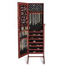 I prefer the dark brown or the black but I WANT ONE for my birthday :)  SUCH a good idea – full length mirror with jewelry box inside <3 SO clever.    Safekeeper Mirror Jewelry Organizer