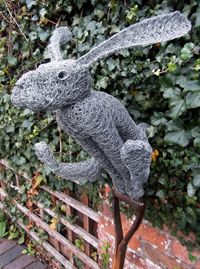 Leaping Hare Rabbit wire garden sculpture by David Metcalff. Unusual gift ideas. Buy online at www.jinneyring.co.uk