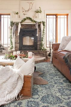 When you take a fantastic rug, lots of evergreen, fur rugs, rustic wood, and white accents, you get my cozy and simple farmhouse Christmas living room decor. #christmas #christmasdecor #FarmhouseChristmas