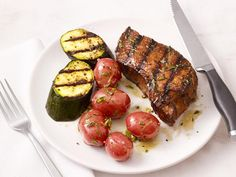 This easy weeknight dinner features Grilled Steak and Zucchini plus herb oil and lemon juice dressed potatoes.