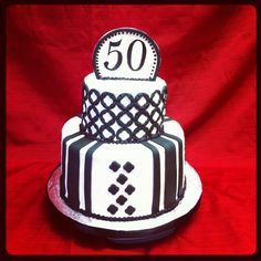 Black and white modern cake for a man's 50th birthday.
