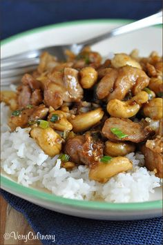 Easy Cashew Chicken with Hoisin Sauce, Garlic Chili Sauce, Water, Boneless Skinless Chicken Thighs, Corn Starch, Salt, Pepper, Vegetable Oil, Sweet Onion, Minced Garlic, Scallions, Rice Vinegar, Roasted Cashews, Cooked White Rice.