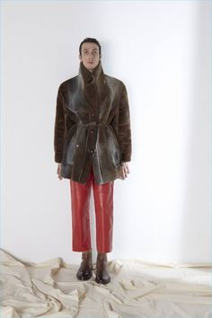 The Beat Generation serves as the beginning inspiration for Maison Margiela's fall-winter 2017 men's collection. Raw hems and quirky proportions come together as the range's key details. Here, elongated coats complement cropped pleated trousers with a relaxed leg. Meanwhile, crewneck sweaters, distressed denim, and ombré treated leather boots complete the season's sound statement. Related: Maison... [Read More]