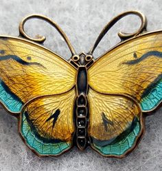 Sterling butterfly pin enamel guilloche by David Anderson of Norway circa 1955. Measurements in inches: 1-1/2 inches X 7/8 inches. Shades of rich