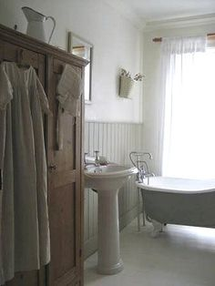 Love the armoire in the bathroom.
