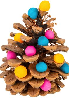 One of our very favourite Christmas crafts for kids. Collect pine cones and decorate with little baubles made from playdough or glue on tiny pom poms or beads