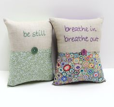 hand-embroidered linen and cotton pillow- ''breathe in breathe out''- meditation pillow. $33.00, via Etsy.