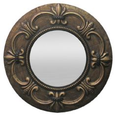 Featuring a bronze-finished metal frame with textural fleur-de-lis details, this stylish wall mirror is perfect for reflecting light in the foyer or creating...