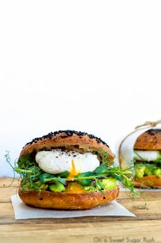 Bagels with smoked salmon, fresh spinach and cream cheese or mashed avocado, pea shoots and poached egg.