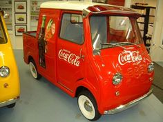 Coca Cola -- 1959 Goggomobil Transporter Pickup is the rarest of the rare. This example has been restored with new old stock metal panels found in Germany.