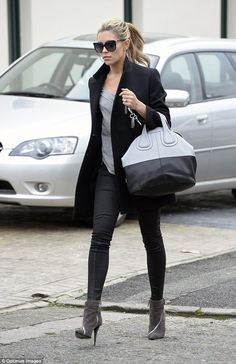 Abbey Clancy.. so chic and form-fitting with a Givenchy Medium Nightingale bag in mushroom and black leather..