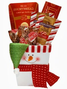 Sweet Snowman Holiday Basket - Product Code: J13072951 This sweet snowman filled gift basket sends best wishes for a happy holiday season and sincere thanks for their loyalty and goodwill throughout the year. Decorative snowman gift basket filled with: Ghirardelli Hot Cocoa Packs Hazelnut Biscotti Shortbread Cookies Chocolate Smores Price: $39.99