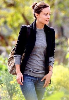 Olivia Wilde demonstrating the perfect black-blazer-grey-sweater combo.