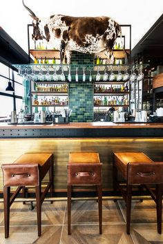By employing exclusive materials and hand-made furnishings – redolent of classic New York and Chicago steakhouses – Inhouse has created a contemporary allusion to a tradition of skilled butchery. Designed by Inhouse Brand Architects African Interior Design, Bar Interior Design, Cafe Design, Modern Restaurant, Cafe Restaurant, Restaurant Design, Restaurant Interiors, Butcher Shop And Grill, Decoration Restaurant
