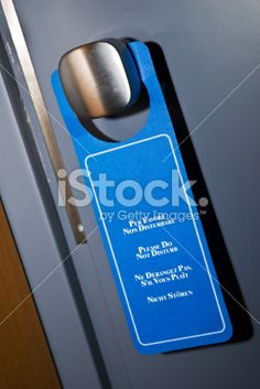 Blue Sign Please Do Not Disturb! on an Hotel's Door Royalty Free Stock Photo