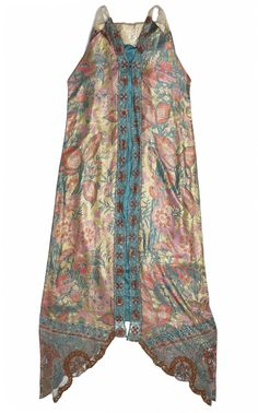 Woman's evening dress of greenish-blue silk satin, woven with coloured silk threads and gilt metal threads, and trimmed with silk net and a brooch: French, Paris, by Callot Soeurs, c. 1922  Museum reference A.1970.1042