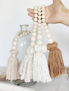 Add a little extra texture to your home with a beautiful tassel. Made with wood beads and high quality yarn they're perfect for a touch of texture and can be used as decor, for wrapping and gift giving. Beautiful neutral colors add just the right amount Wood Bead Garland, Beaded Garland, Garlands, Boho Diy, Boho Decor, Yarn Crafts, Bead Crafts, Diy Girlande, Creation Deco