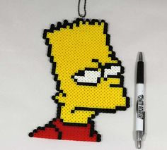 This Bart Simpson Pixel Art Necklace Perler Bead Sprite is great for hanging around your neck, around the car rear view mirror, on the fridge, sitting on your desk or table! Bring back memories and dive back into your childhood with this cool Bart Simpson Pixel Art Necklace Perler Bead Sprite! This creative art is handmade and very sturdy and durable!  Our Favorite Cartoon Character can now be yours as a decorative and create art piece! Wear it and tell people to Eat My Shorts!  Makes a…