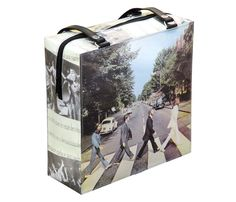 This handbag is made using a cover of The Beatles Abbey Road record. Covered with strong clear plastic. Features:  - Three inner pockets - YKK zippers - Polyester fabric lining - Vinyl hand straps   Dimensions in Inches: Height 14 Length 14 Width 4.3  Dimensions in centimeters: Length 35.5 cm Height 35.5 cm Width 11 cm  Length of hand straps: 30.7 ( 13.8 drop down ) --- 78 cm ( 35 cm drop down )  **************************************************  More handbags using records, or handbags…