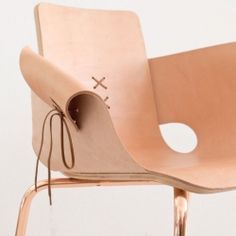Martín Azúa, Spanish designer presents Shoemaker flesh, made of wood, leather and lace, this chair takes some codes of the shoe to draw the line.