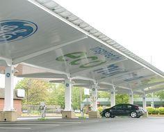 GE's Solar Carport solution combines several GE technologies-including GE EverGoldTM combiner boxes and disconnects, GE's Durastation and Wattstation electric vehicle (EV) charging stations, and AC distribution equipment-to integrate EV and solar into a grid-tie photovoltaic system used for charging EV fleets. GE's Solar Carport solution, when combined with solar panels, inverters, and a carport structure provides EV fleet owners a turn-key charging solution.