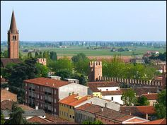 Picture taken from the top of the tower Rocca degli Alberi.   It shows a segment of the medieval walls of Montagnana, one of the best preserved examples of medieval walls in Europe.   On the left the bell tower of S.Francis church.   Outside the walls the green countryside around Padua.