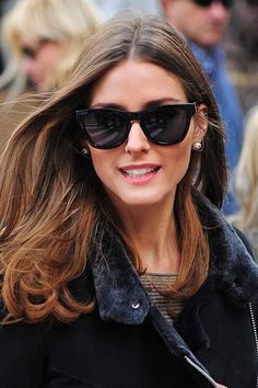 The latest cat-eye designs are a decidedly modern accessory for those with oval faces, like Olivia Palermo.   - ELLE.com