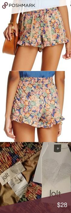 Flowy Fun Floral Crocheted Ruffle Shorts beautiful floral pattern with crochet detail running down legs of shorts and ruffles at the bottom tags are still attached 90% polyester 10% spandex stretchy and comfortable for all day wear silky soft smooth feel purchased for 40$ im down to a small and these beauties do not fit :( Jolt Shorts