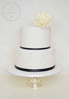 Classically elegant wedding cake with sugar peony