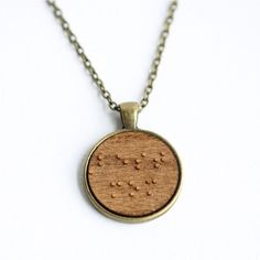 "Interesting one by lemonwood_market #braille #doitbraille (o) http://ift.tt/25Yzs4b've got your Mother's Day covered! Subtle and unique pendant necklace reads ""best mom"" in Braille... Perfect message for that humble lady in your life who wouldn't otherwise broadcast she's the best  Just one of our Mother's Day pieces  #wood #bestmom #mothersday #uniquemom #uniquemothersday #giftforher"