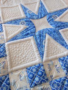Quilting by Judi Madsen.  Pieced quilt by Kimberly Einmo.