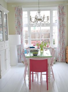 I love this! Especially the white painted floors!!  And the painted pink chairs and the long drapes!!!